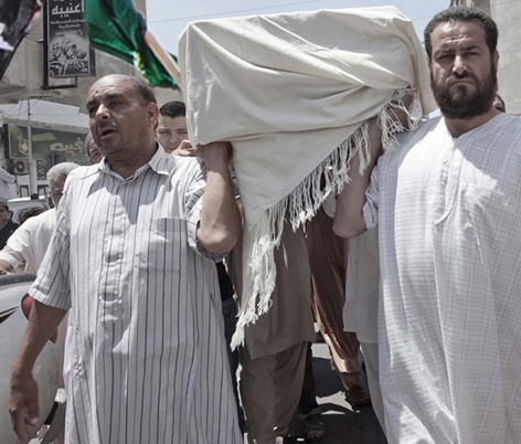 [cml_media_alt id='6261']men carrying a coffin[/cml_media_alt]