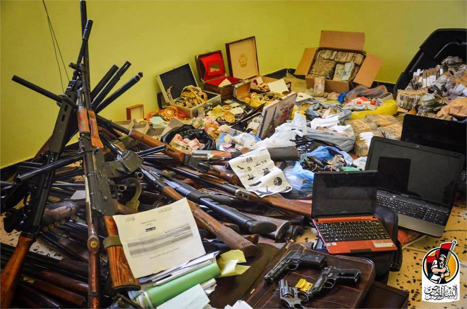 Gold, money, Tunisian currency, and weapons found inside ISIS Hisbah building in Sirte 1